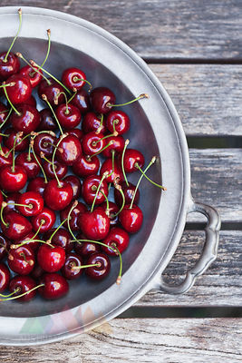 Zinc bowl of sweet cherries