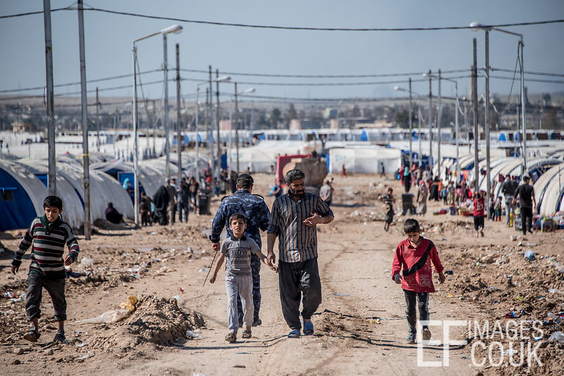 People Walking Through Hamam al Alil IDP Camp Near Mosul
