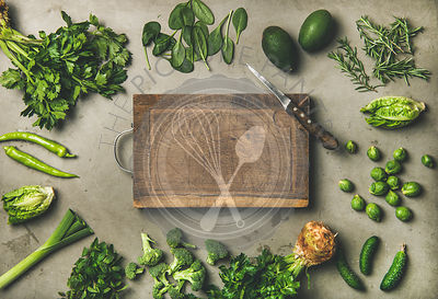 Healthy vegan ingredients and wooden board in center