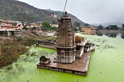 Varuna temple in the algae-filled waters of Nawal Sagar, Bundi, Rajasthan, India