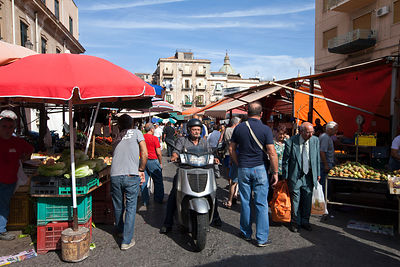 Italy - Palermo - A man drives his scooter through the Capo Market