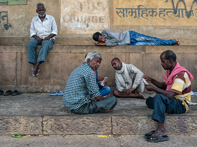 An everyday scene at any Indian street. People play cards in their free time. This image was shot in Varanasi