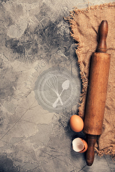 Top view on Old Kitchen cooking utensils on grey stone table - cooking concept