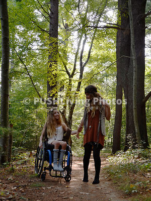 Young girl in a wheelchair in the forest
