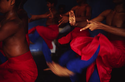 India - Kerala - Boys practice at dawn at a dance class at the Kerala Kalamandalam