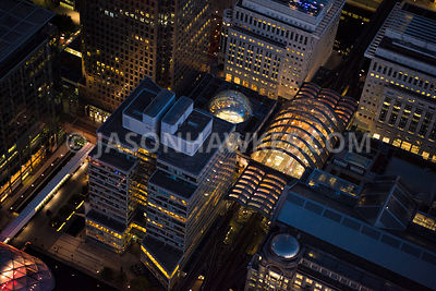 Aerial view of East London, Docklands, Canary Wharf Shopping Centre at night time.