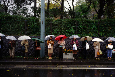 Japan - Hakone - Women waiting for a bus in the rain
