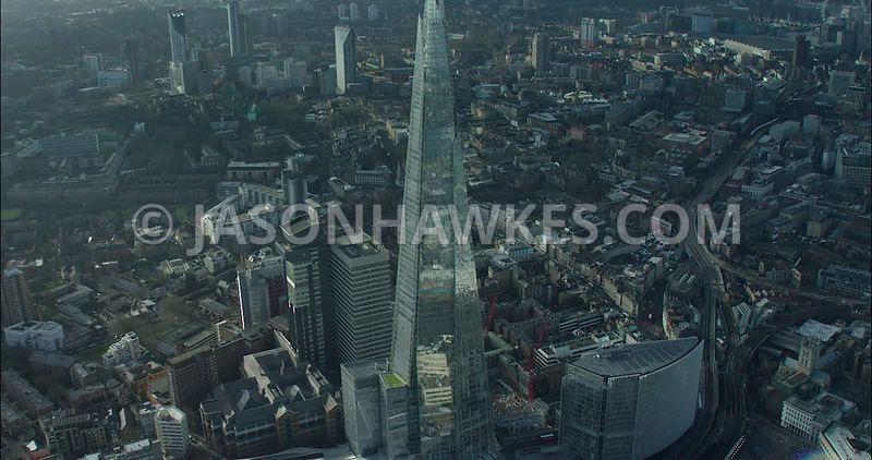 London Aerial footage, The Shard close up with London Bridge Station.