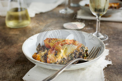 Wild Rice Kale Tomato Casserole with a Cheddar Cheese Sause