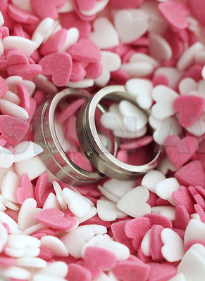 Wedding rings in sweet sugar hearts