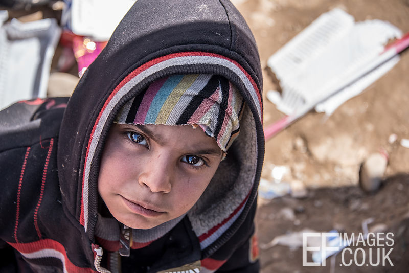 Distressed Boy Alone In The Transit Area At Hamam al Alil IDP Camp Near Mosul