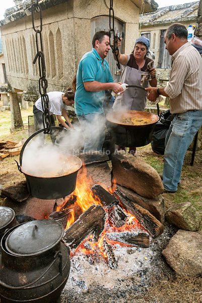 Preparing chanfana, a traditional dish made with roasted old goat, potatoes, red wine, garlic, laurel and pepper, prepared during the Rye Harvest Festival for a community meal. Lindoso, Peneda Geres National Park. Alto Minho, Portugal