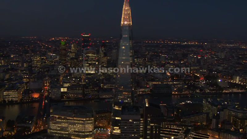 Aerial footage of The Shard and the City at night, London