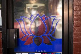 A sign of lotus flower on a door of a restaurant in Kathmandu, Nepal.