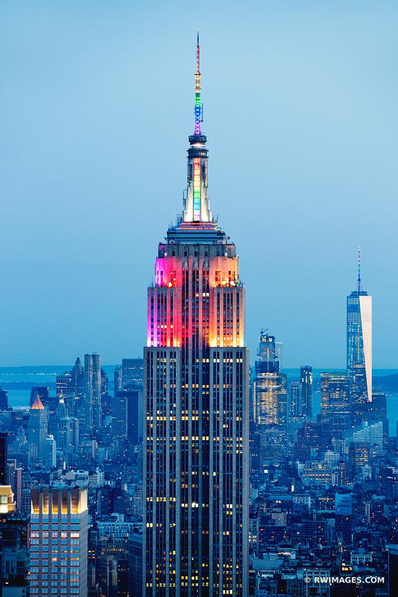 GAY PRIDE RAINBOW COLORS LIT EMPIRE STATE BUILDING MANHATTAN SKYLINE NEW YORK CITY EVENING VERTICAL