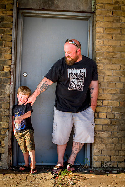 Brandon Schneider, a claims adjuster, with his son in Watertown, South Dakota