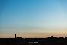 Silhouette of a man standing on hill in the South Gobi Desert, Mongolia.  In the Khongoryn Els sand dunes in Gobi Gurvansaikhan National Park
