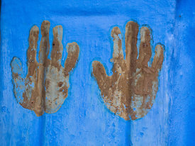 Hand prints are considered to be auspicious in many cultures in India. It is believed that they bring good luck and ward off evil. This photograph of a woman's hand print was shot in Jodhpur