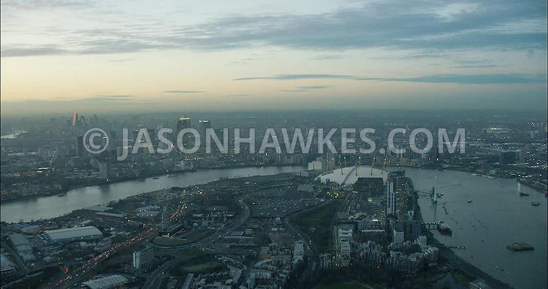 London Aerial Footage Greenwich Peninsula and River Thames at night.