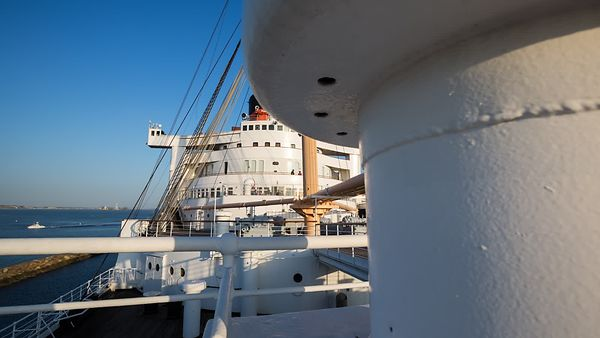 Wide Shot: Revealing Wide Horizontal Move On The Deck Of The Queen Mary (Day To Night)