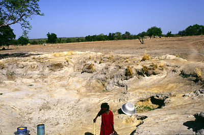 Ghana - Arigu - Asumpaheme, who is blind, collects water at a water hole