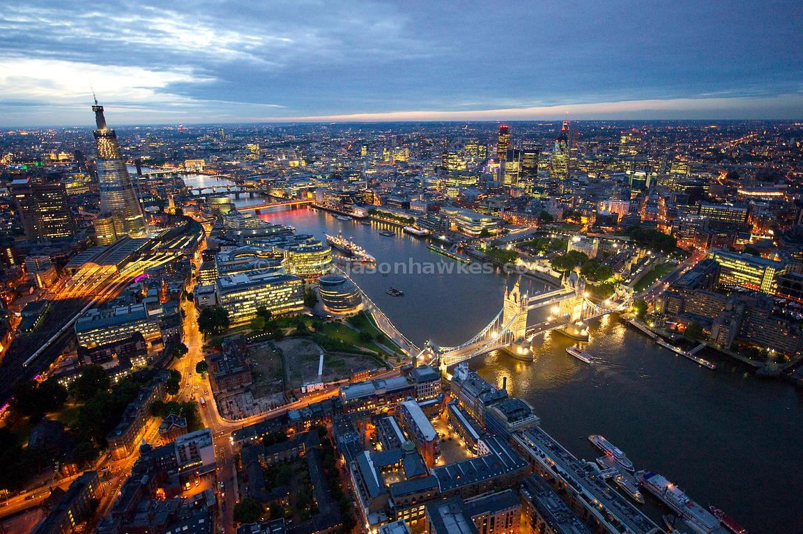 Aerial View. Tower Bridge at night, London . Jason Hawkes