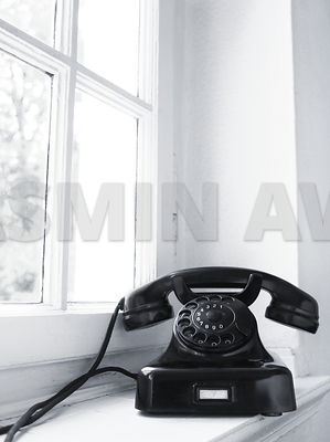 Old Vintage Black Telephone Sitting on Window Sill