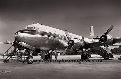 DC-6B NZ3633 parked after a VIP flight - Changi January 1962