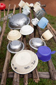 Kitchen utensils drying on a washing rack outside rural village home, Kenya.