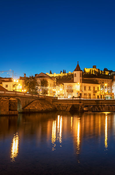 The historic site of Tomar at dusk. The bridge of roman origin and, on the top of the hill, the castle of the Templars Convent of Christ. Tomar, Portugal