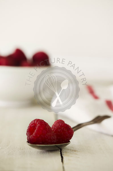 Raspberries in Spoon on White Background