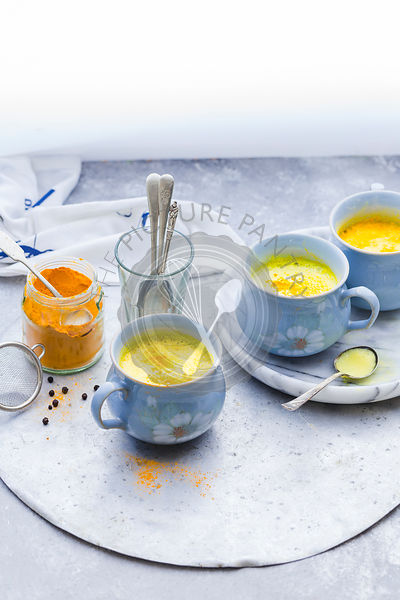 Golden Turmeric Milk served in Blue Mugs