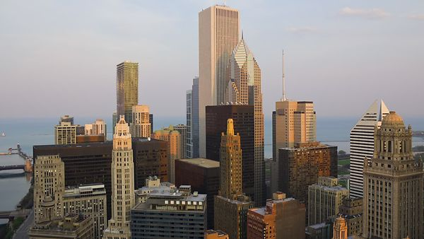 Wide Shot: Clear Day To Night Over Art Deco Mid-Rises & Modern High-Rises