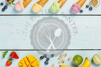 Various of ice cream flavor in cones pink(strawberry, raspberry), purple (blueberry), green (pistachio, green tea, lime) and yellow (mango, banana) setup on blue wooden background . Summer and Sweet menu concept flat lay.