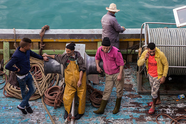 Fishermen Waiting to Unload their Catch
