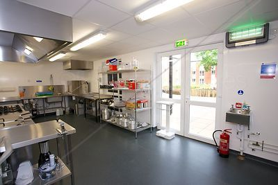 Fire Exit Blocked in Commercial Kitchen
