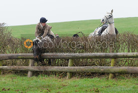 Harry McEuen and Harry Pepper jumping a hedge at Stone Lodge Farm
