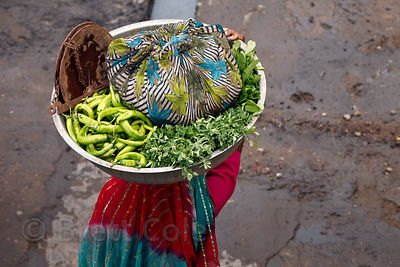 Aerial view of a woman carrying vegetables on her head in Jaipur, Rajasthan, India