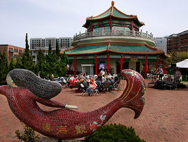 Several dozen people gather in downtown Norfolk, Sunday, April 6, 2014, for food and live music at the Spring Celebration Weekend at the Pagoda Restaurant & Oriental Gardens. (Stephen M. Katz/The Virginian-Pilot)