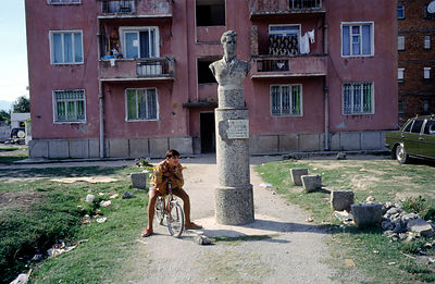 A boy by a Socialist statue