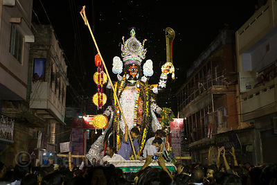 A huge idol of Kali is carried during the Kali Murti festival, Varanasi, India. It will be marched into the streets where thousands of people will work themselves into a frenzy with drumming and fireworks.
