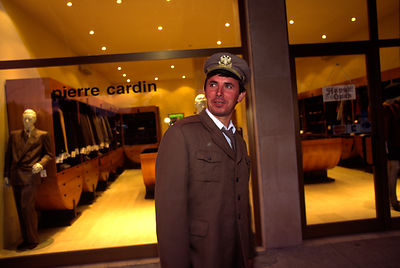 Security guard outside a Pierre Cardin shop in Tirana