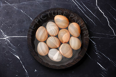 Guinea-fowl eggs on marble background