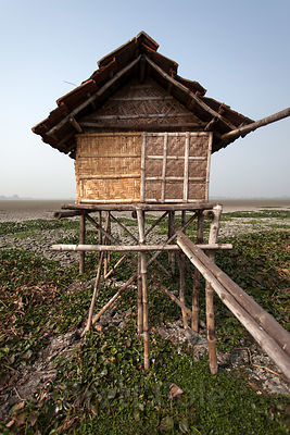 A fishing hut sits suspended over parched land in the East Kolkata Wetlands, Kolkata, India.