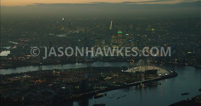 London night aerial footage, O2 Arena with River Thames at night.