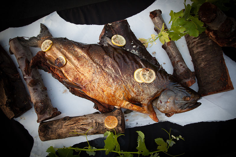 Wild caught smoked salmon served on parchment paper. Photo by Jason Tinacci
