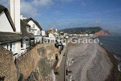 Sidmouth shore, south Devon, England, with thatched buildings in foreground
