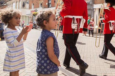 Children clap the Band of the Irish Guards