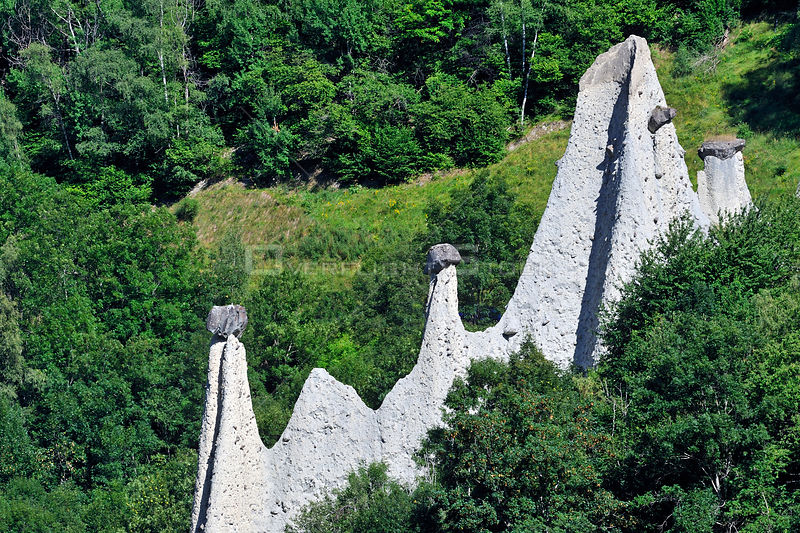 Pyramids of Euseigne, formed by erosion of soft rock below hard rock, Valais, Switzerland, July 2009