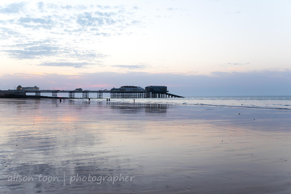 Cromer beach and pier at sunset